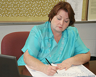 Older woman working at her desk
