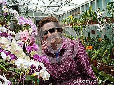 Older Women Gardener with Orchids