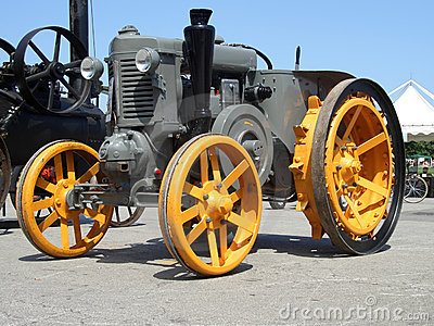 Older yellow grey tractor, fro