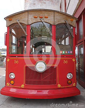 Oldfashioned red trolley bus front on. Editorial Stock Photo