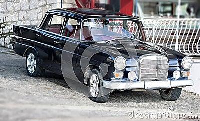 Oldtimer retro vintage car limousine at street