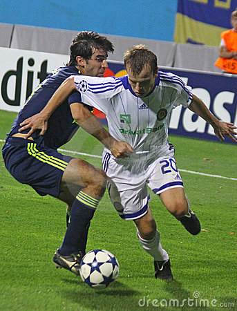 Oleg Gusev of Dynamo Kyiv (R) and Oleguer of AFC A Editorial Photography