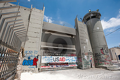 Olive Branches and Israeli Separation Barrier Editorial Stock Photo