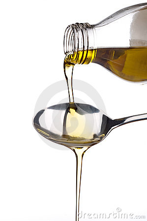 Olive oil being poured onto a spoon