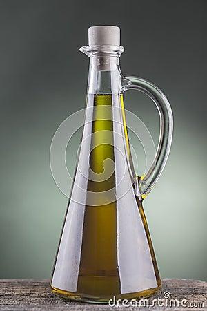 Olive oil bottle with green spotlight background