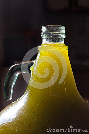 Olive oil bottle in the light
