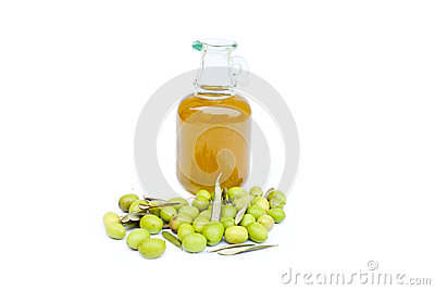 Olive oil bottle with olives