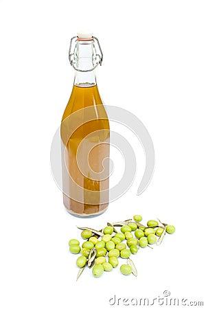 Olive oil bottle with olives