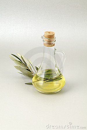 Olive oil bottle silver background