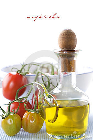 Olive oil and branch of organic tomatoes