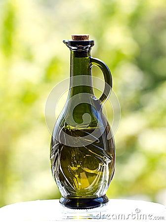 Olive oil in olive embossed bottle