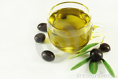 Olive oil, olives and branch
