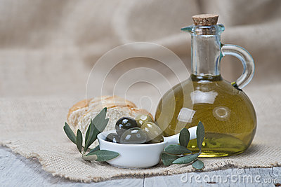 Olive oil with olives and bread