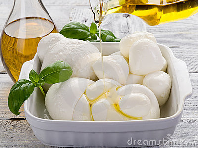 Olive oil over mozzarella