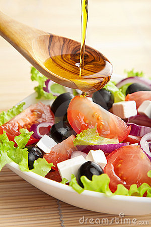 Free Olive Oil Pouring Over Salad Stock Images - 13129524