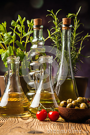Olive oils in bottles with ingriedients