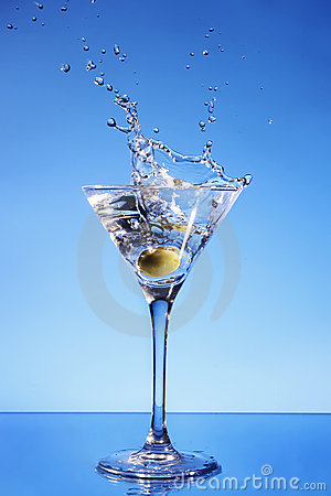 Olive splashing in a Martini glass
