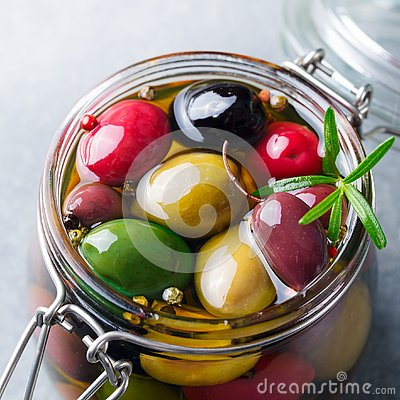 Free Olives Assortment In Glass Jar With Oil. Close Up. Stock Images - 125264514