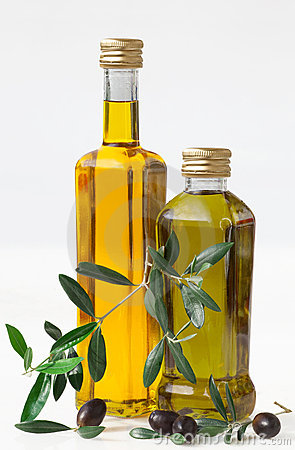 Olives and bottle with olive oil