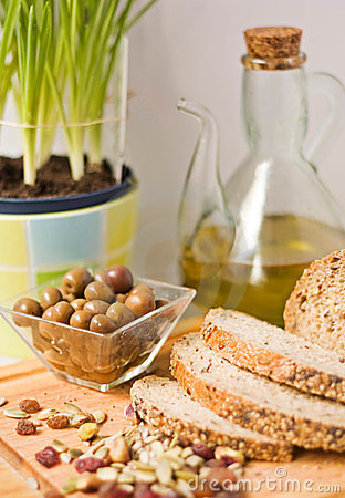 Olives, bread, seed and olive oil.