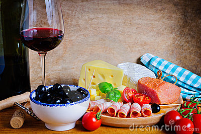 Olives, cheese, ham and wine
