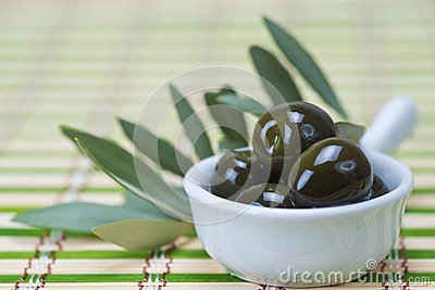 Olives in a china spoon