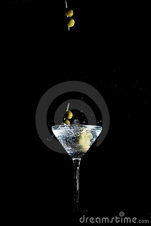 Free Olives On A Toothpick Dropped Into A Glass Royalty Free Stock Photography - 993227