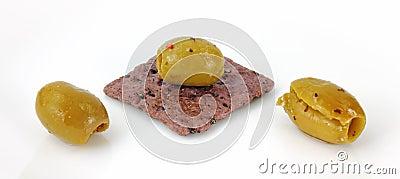 Olives on rice cracker