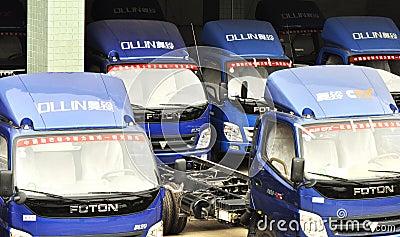 Ollin light trucks warehouse Editorial Stock Image