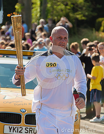 Olympic 2012 Torch Relay Runner Editorial Photo