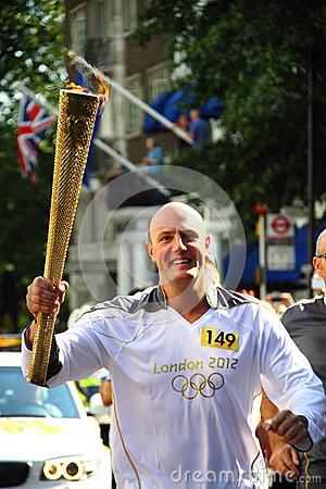 Olympic 2012 torch runner Editorial Stock Photo