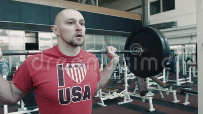 Olympic athlete does workout with weight bar stock footage
