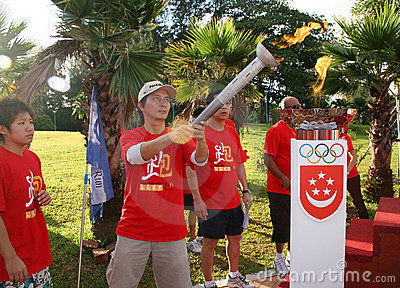 Olympic day run lighting torch Editorial Photography