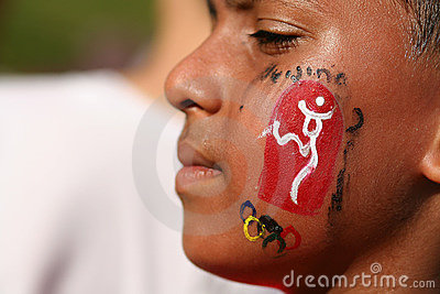 Olympic day run participant with face painting Editorial Photo