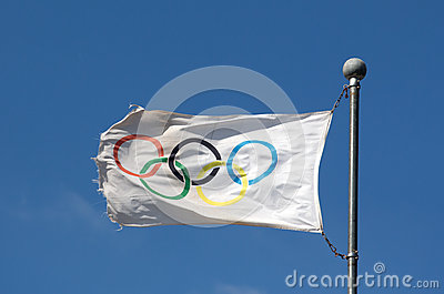 Olympic flag against a blue sky in sunlight Editorial Stock Photo