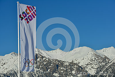 Olympic flag over the snowy mountains Editorial Stock Image