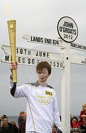 Olympic Flame at John O Groats sign, Scotland Editorial Image