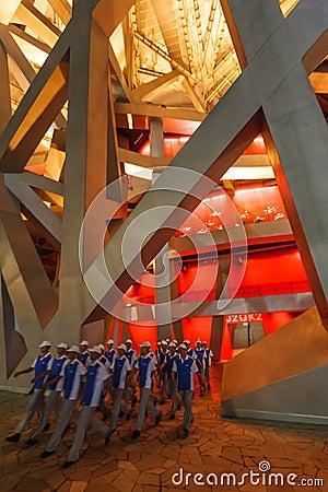 Olympic men volunteers enter Birds Nest Stadium Editorial Image
