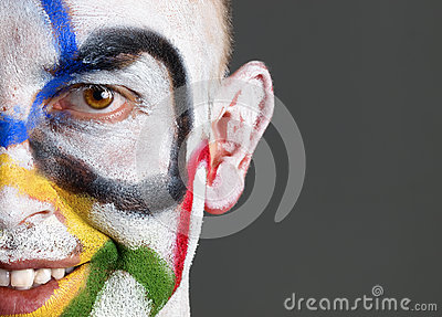 Olympic rings painted on the face of smiling man Editorial Stock Photo