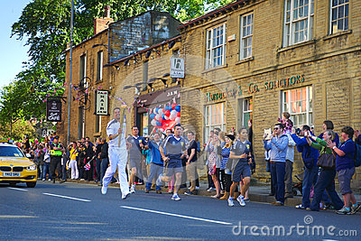Olympic torch relay runner, Headingley, Leeds, UK Editorial Photo