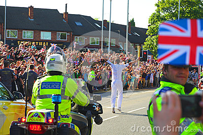 Olympic torch relay runner, Headingley, Leeds, UK Editorial Photography