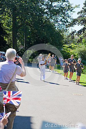 Olympic Torchbearer in Kew Gardens Editorial Stock Photo