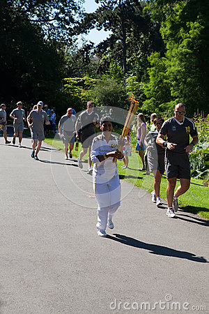 Olympic Torchbearer in Kew Gardens Editorial Image