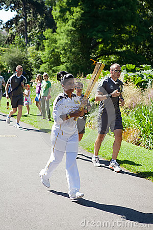 Olympic Torchbearer in Kew Gardens Editorial Photography