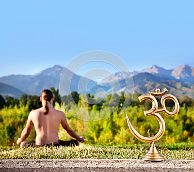 Om statue and meditation