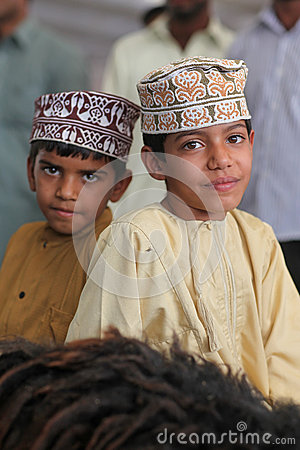 Oman boys with traditional clothing Editorial Stock Photo