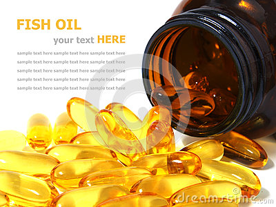 Omega 3 fish oil capsules spilling out of a bottle