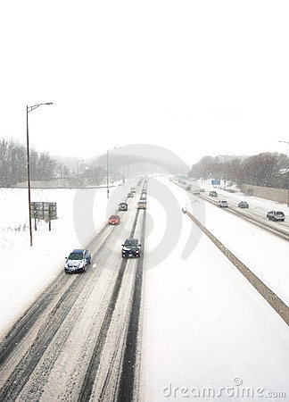 Oncoming traffic in a snowstorm Editorial Stock Photo