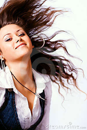 One active woman with long hair in motion