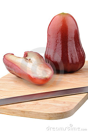 Free One And A Half Of Red Rose Apple On Chopping Board Royalty Free Stock Image - 18701156